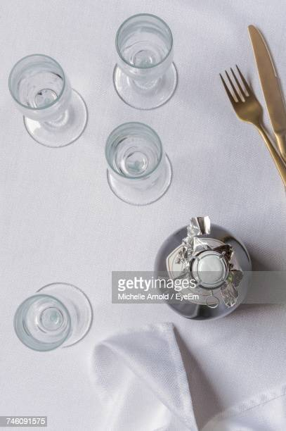 Directly Above Shot Of Champagne Bottle With Empty Flutes On Table