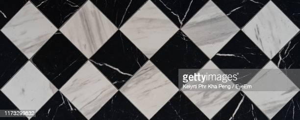directly above shot of checked flooring - checked pattern stock pictures, royalty-free photos & images
