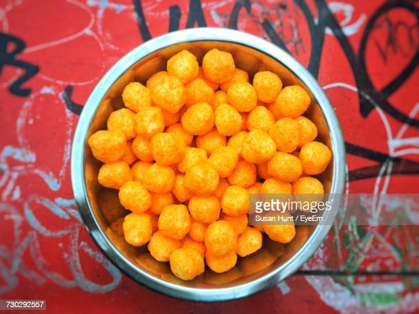 Directly Above Shot Of Cheese Balls In Bowl On Table