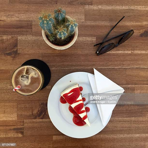 Directly Above Shot Of Cheesecake With Coffee And Sunglasses On Table