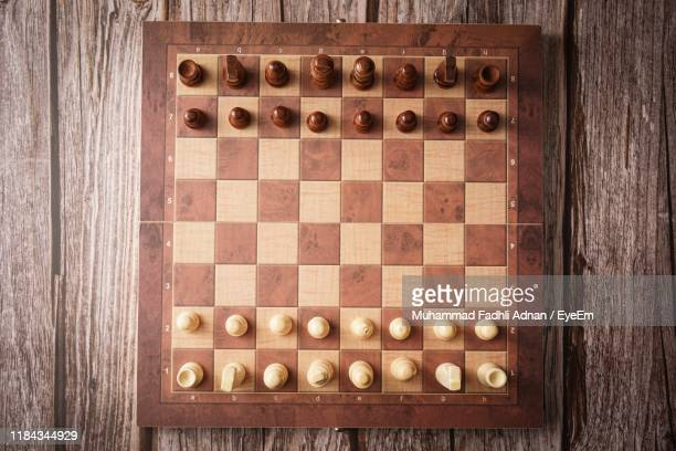 directly above shot of chess board on table - chess board stock pictures, royalty-free photos & images