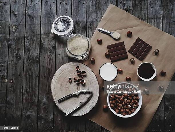 directly above shot of chestnuts with flour and chocolate on table - chocolate making stock pictures, royalty-free photos & images
