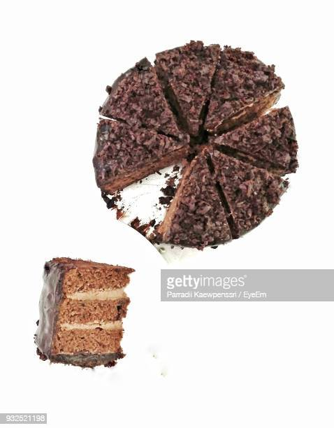 directly above shot of chocolate cake against white background - chocolate cake above stock pictures, royalty-free photos & images