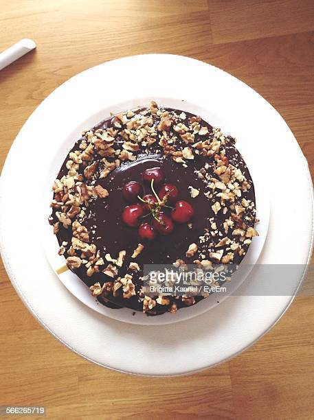 directly above shot of chocolate cake in plate on table - chocolate cake above stock pictures, royalty-free photos & images
