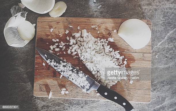 Directly Above Shot Of Chopped Onions On Cutting Board