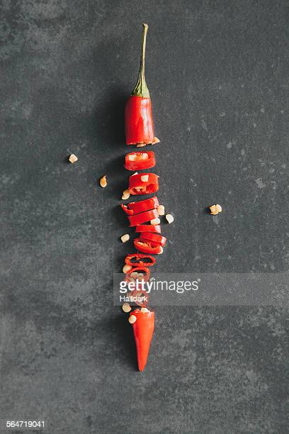Directly above shot of chopped red chili pepper on table