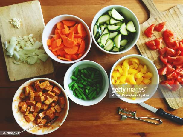 directly above shot of chopped vegetables on wooden table - yellow bell pepper stock pictures, royalty-free photos & images