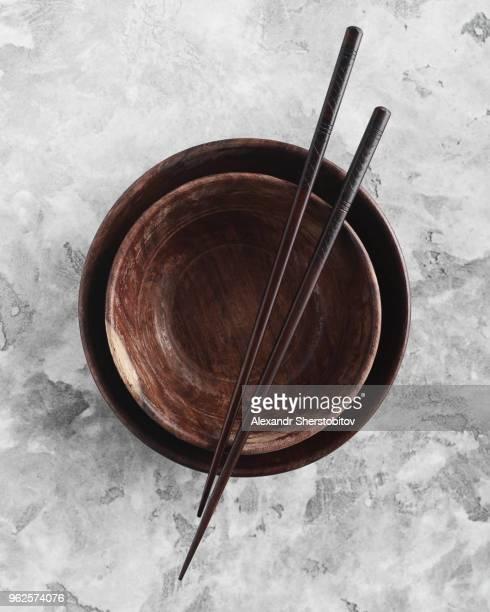 Directly above shot of chopsticks on empty bowls