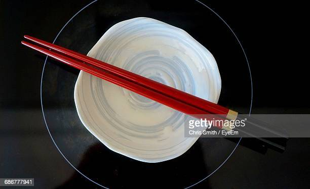Directly Above Shot Of Chopsticks On Top Of Bowl