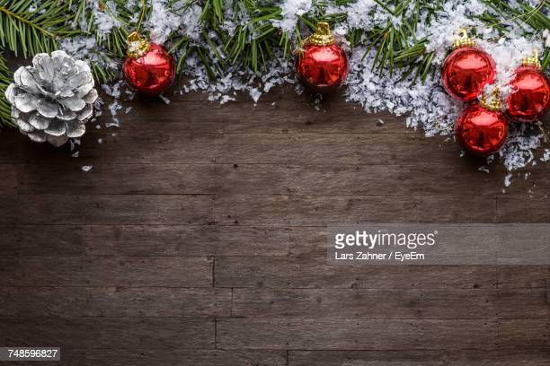 Directly Above Shot Of Christmas Decoration On Hardwood Floor