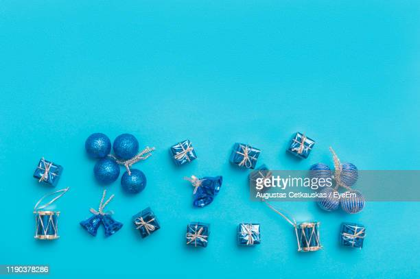 directly above shot of christmas decoration over turquoise background - cetkauskas stock pictures, royalty-free photos & images