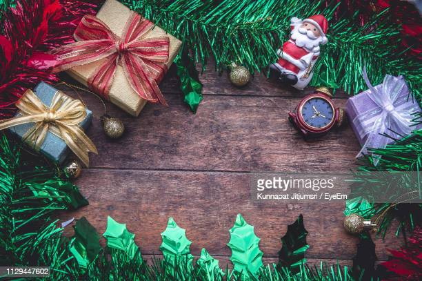 directly above shot of christmas decorations on wooden table - craft product stock pictures, royalty-free photos & images