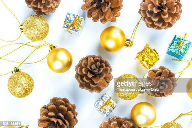 Directly Above Shot Of Christmas Decorations Over White Background