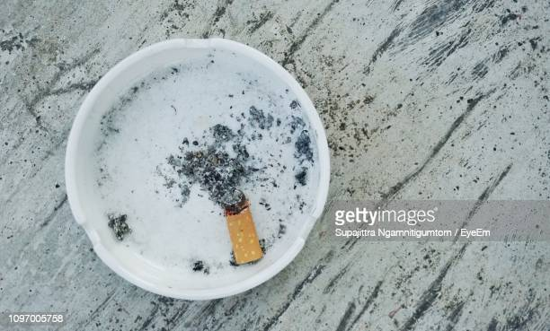 directly above shot of cigarette butt in ashtray - ash stock pictures, royalty-free photos & images