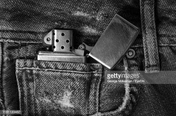 directly above shot of cigarette lighter in jeans pocket - cigarette lighter stock pictures, royalty-free photos & images
