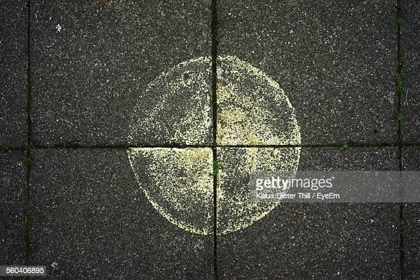 Directly Above Shot Of Circle Drawn On Sidewalk