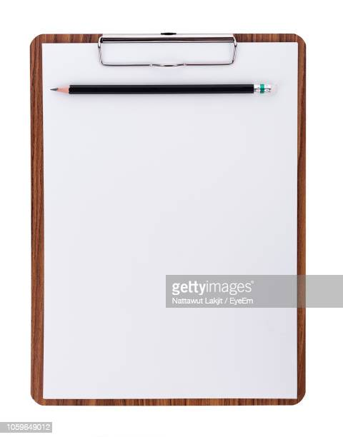 directly above shot of clipboard against white background - clipboard stock pictures, royalty-free photos & images