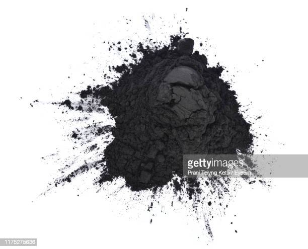 directly above shot of coal over white background - coal stock pictures, royalty-free photos & images