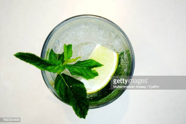 directly above shot of cocktail in glass over white background - mojito stock photos and pictures