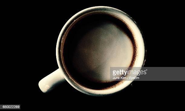 Directly Above Shot Of Coffee Against Black Background