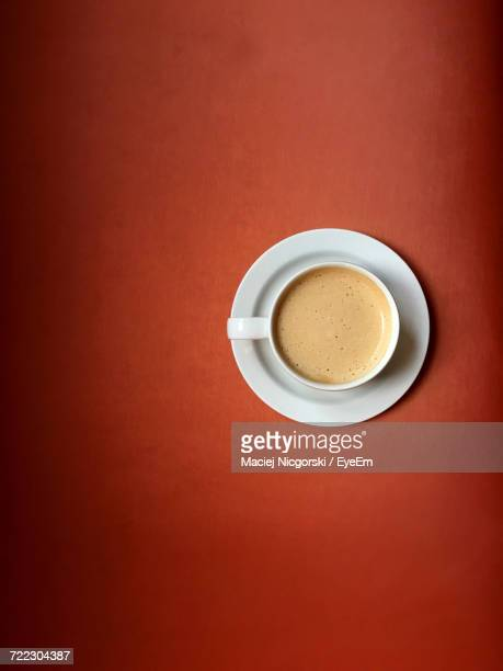 Directly Above Shot Of Coffee Against Orange Background
