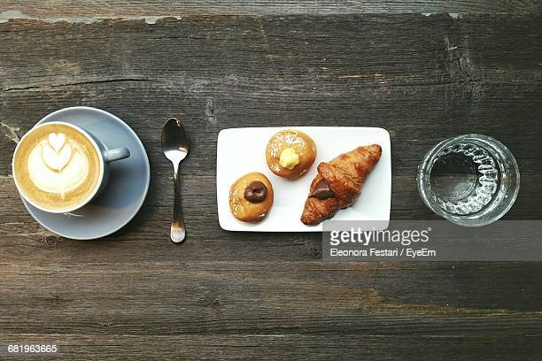 Directly Above Shot Of Coffee And Chocolate Croissants On Table
