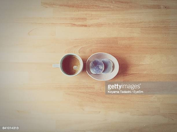 Directly Above Shot Of Coffee And Daifuku Mochi On Hardwood Floor