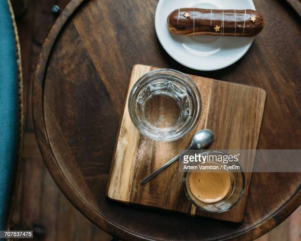 Directly Above Shot Of Coffee And Pastry Served On Wooden Table