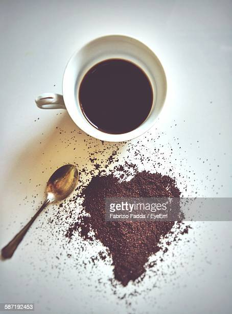 Directly Above Shot Of Coffee And Powder On Table