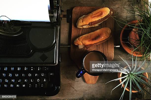 Directly Above Shot Of Coffee And Sandwiches By Laptop On Table