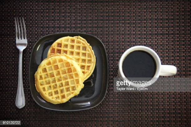 directly above shot of coffee and waffle on table - waffle stock photos and pictures