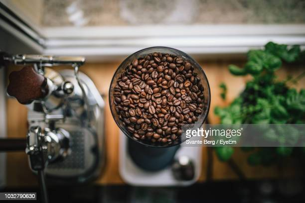 directly above shot of coffee beans in machinery - coffee maker stock pictures, royalty-free photos & images