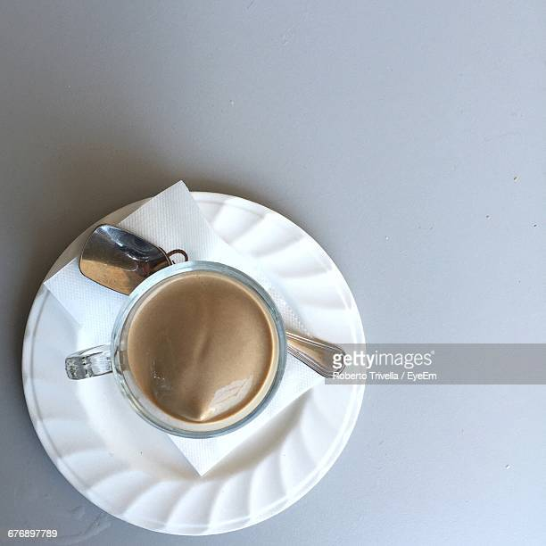 Directly Above Shot Of Coffee Cup In Saucer Against White Background