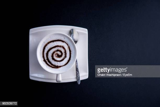 Directly Above Shot Of Coffee Cup On Black Background