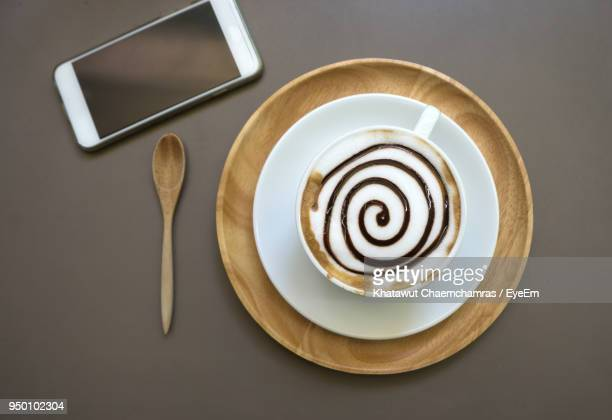 directly above shot of coffee cup on table - mocha stock photos and pictures