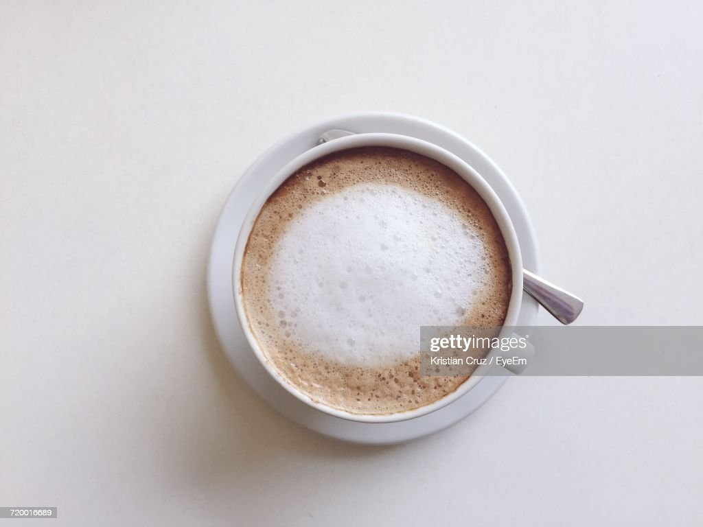 Directly Above Shot Of Coffee Cup On White Background : Stock Photo