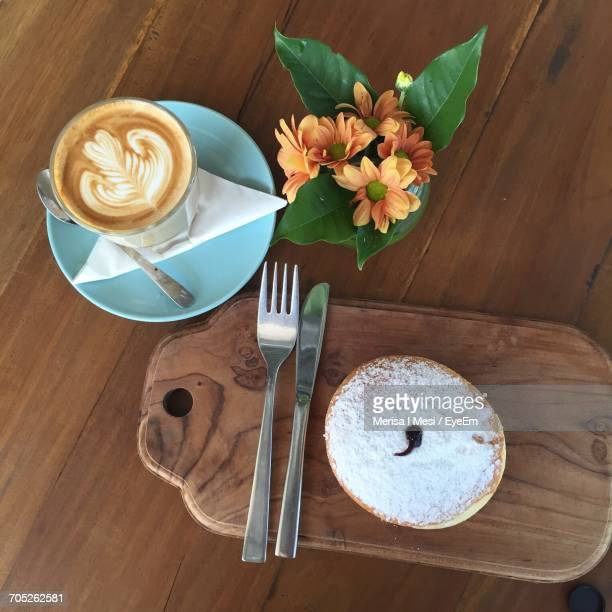 Directly Above Shot Of Coffee Cup On Wooden Table
