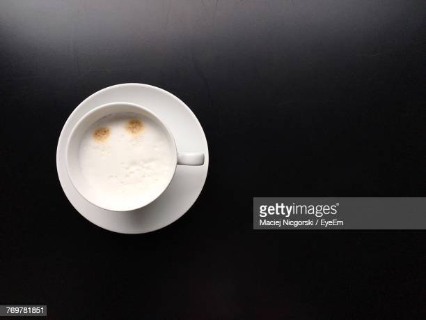 directly above shot of coffee cup over black background - saucer stock pictures, royalty-free photos & images
