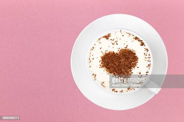 directly above shot of coffee cup over pink background - saucer stock pictures, royalty-free photos & images