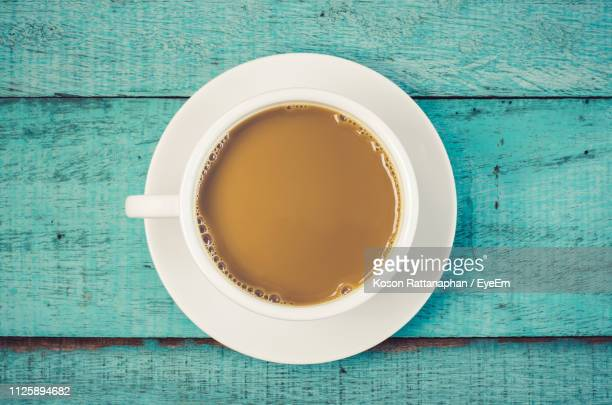directly above shot of coffee cup served on wooden table - tea cup stock pictures, royalty-free photos & images