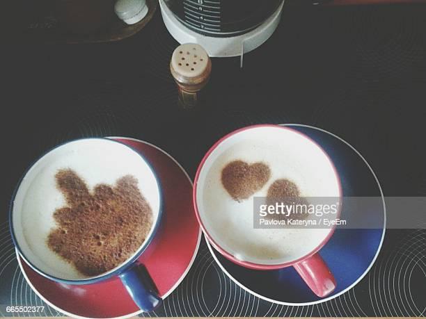 Directly Above Shot Of Coffee In Cups On Restaurant Table