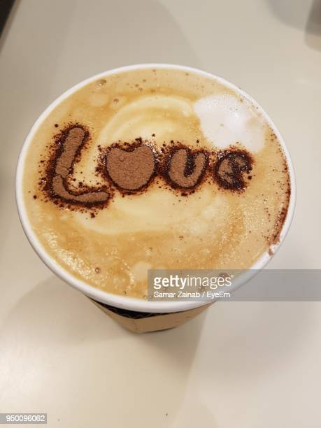 Directly Above Shot Of Coffee Love Text On Table