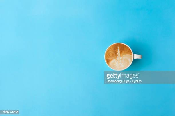 directly above shot of coffee on blue background - blue background stock pictures, royalty-free photos & images