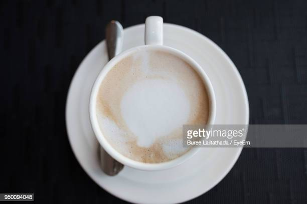 directly above shot of coffee on table - frothy drink stock pictures, royalty-free photos & images