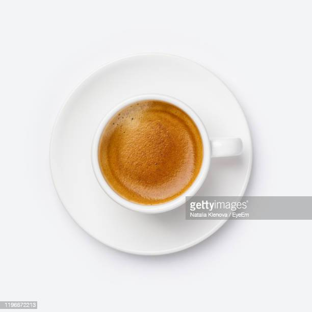 directly above shot of coffee on white background - veduta dall'alto foto e immagini stock