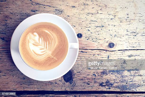 Directly Above Shot Of Coffee On Wooden Table