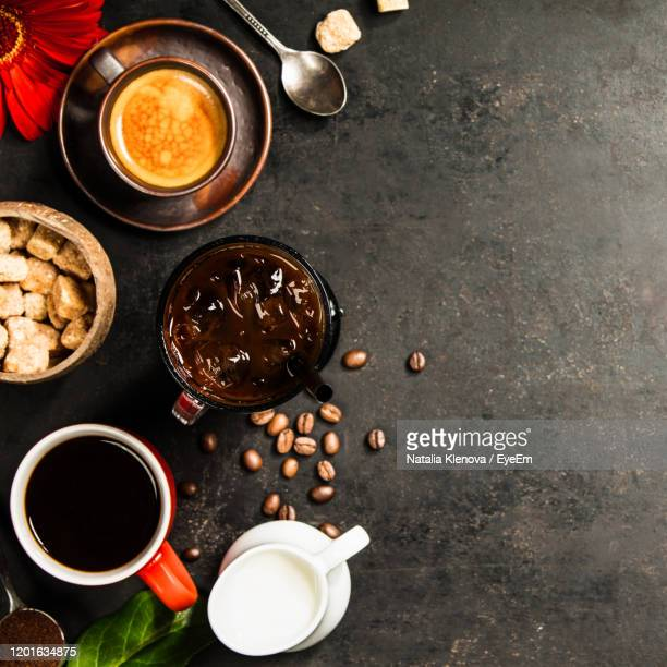 directly above shot of coffee with leaf and drink on floor - coffee drink stock pictures, royalty-free photos & images