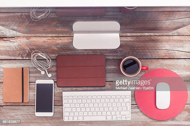 Directly Above Shot Of Coffee With Technologies On Table