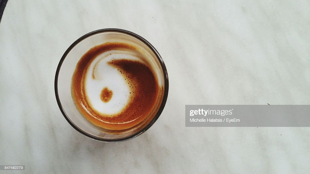 Directly Above Shot Of Coffee With Yin Yang Symbol Stock Photo