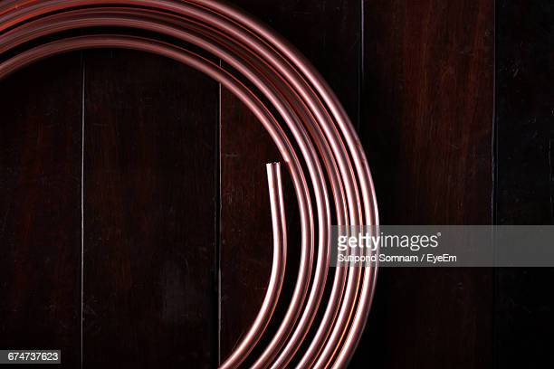 Directly Above Shot Of Coiled Copper On Table